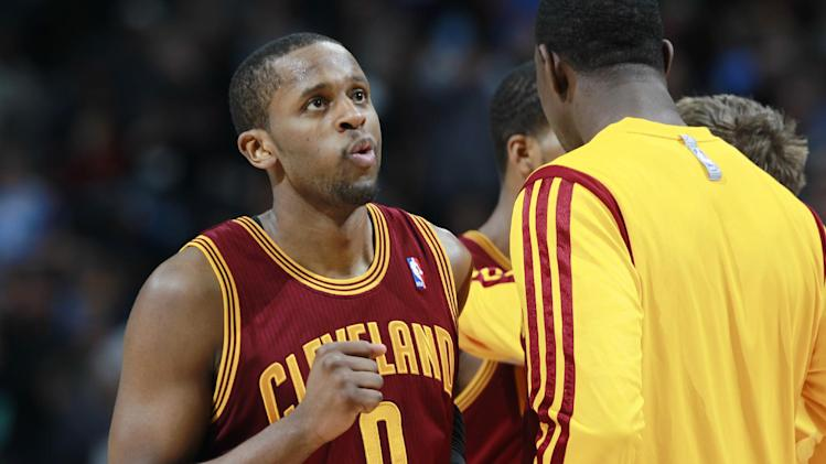 Cleveland Cavaliers guard C.J. Miles reacts as he heads to a timeout with only seconds remaining in the fourth quarter in an NBA basketball game against the Denver Nuggets in Denver, Friday, Jan. 17, 2014. The Cavaliers won 117-109
