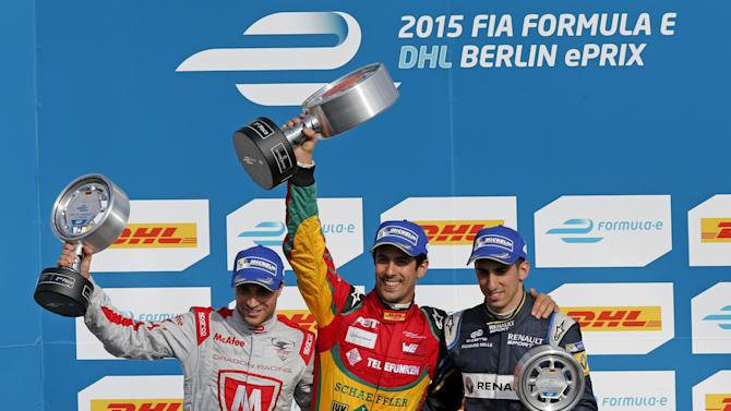 First placed Audi Sport ABT driver Di Grassi, second placed Dragon Racing driver d'Ambrosio and third placed E.Dams Renault driver Buemi celebrate on the podium after the Formula E Championship race in Berlin