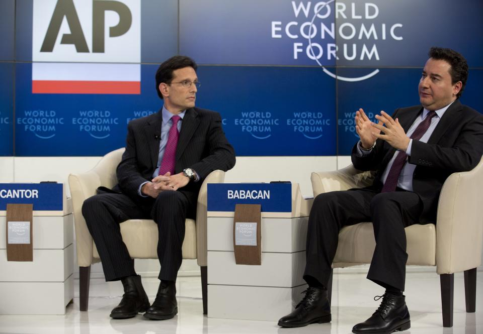 Ali Babacan, right, Turkey's Deputy Prime Minister speaks as U.S congressman Eric Cantor looks on during the Associated Press session 'Creating Economic Dynamism' at the 43rd Annual Meeting of the World Economic Forum, WEF, in Davos, Switzerland, Friday, Jan. 25, 2013.  (AP Photo/Anja Niedringhaus)