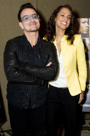 """Bono, left, and Alicia Keys attend the premiere of the Showtime documentary """"Keep a Child Alive with Alicia Keys"""", in New York, Tuesday, Nov. 29, 2011. (AP Photo/Charles Sykes)"""