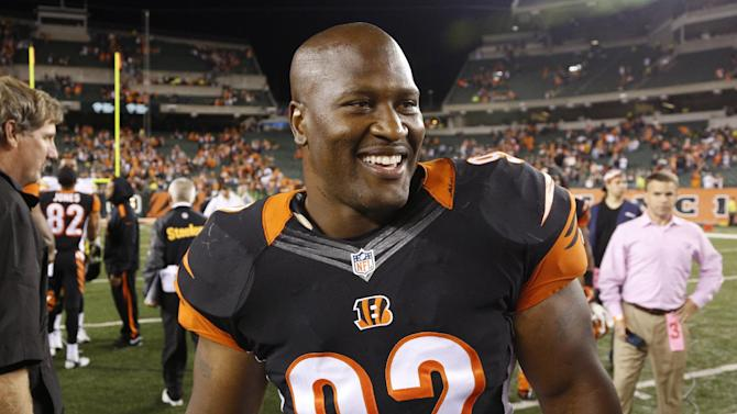 Cincinnati Bengals outside linebacker James Harrison smiles as he leaves the field following their 20-10 win over the Pittsburgh Steelers in an NFL football game, Tuesday, Sept. 17, 2013, in Cincinnati. (AP Photo/David Kohl)