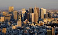 File photo of Tokyo&#39;s Shinjuku area. Japan&#39;s economy was hammered last year&#39;squake-tsunami disaster, which wreaked havoc on industrial production, while flooding in Thailand and the yen&#39;s surge to record highs against the dollar later in the year also hurt growth