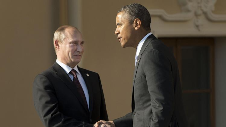 "FILE - In this Sept. 5, 2013 pool-file photo, President Barack Obama shakes hands with Russia's President Vladimir Putin during arrivals for the G-20 summit at the Konstantin Palace in St. Petersburg, Russia. ""We've kind of hit a wall,"" President Barack Obama said on his way to Russia last week. He meant his relationship with Moscow, but the remark came to apply, too, to other leaders abroad, lawmakers at home and even Americans at large, all standing in the way of his plans to punish Syria for using chemical weapons. Just days later, military action is on hold, diplomacy has some steam and Obama no longer looks so alone. (AP Photo/Pablo Martinez Monsivais, Pool-File)"