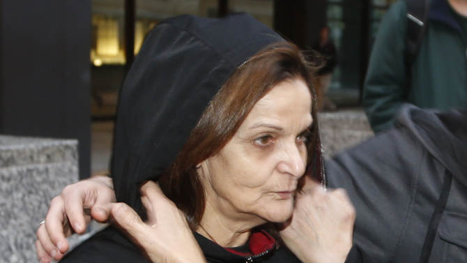 FILE - In this Oct. 22, 2013, file photo, Rasmieh Yousef Odeh stands outside the federal courthouse in Chicago. She is charged with immigration fraud, accused of lying to U.S. immigration officials when she failed to disclose her conviction for a terrorist bombing at a Jerusalem supermarket in 1969 that killed two people.  On Thursday, Oct. 2, 2014, U.S. District Judge Gershwin Drain in Detroit rejected Odeh's lawyers' request to throw out the charges on the basis that they were the result of a selective prosecution because of Odeh's activism in the Arab-American community. The judge scheduled her trial to begin Nov. 2, 2014 in Detroit. (AP Photo/Charles Rex Arbogast, File)