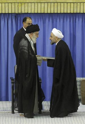 In this picture released by the official website of the Iranian supreme leader's office, Supreme Leader Ayatollah Ali Khamenei, left, gives his official seal of approval to President-elect Hasan Rouhani, in an official endorsement ceremony, in Tehran, Iran, Saturday, Aug. 3, 2013. Iran's supreme leader has formally endorsed Hasan Rouhani as president opening the way for the moderate cleric to take over from outgoing President Mahmoud Ahmadinejad. (AP Photo/Office of the Iranian Supreme Leader)