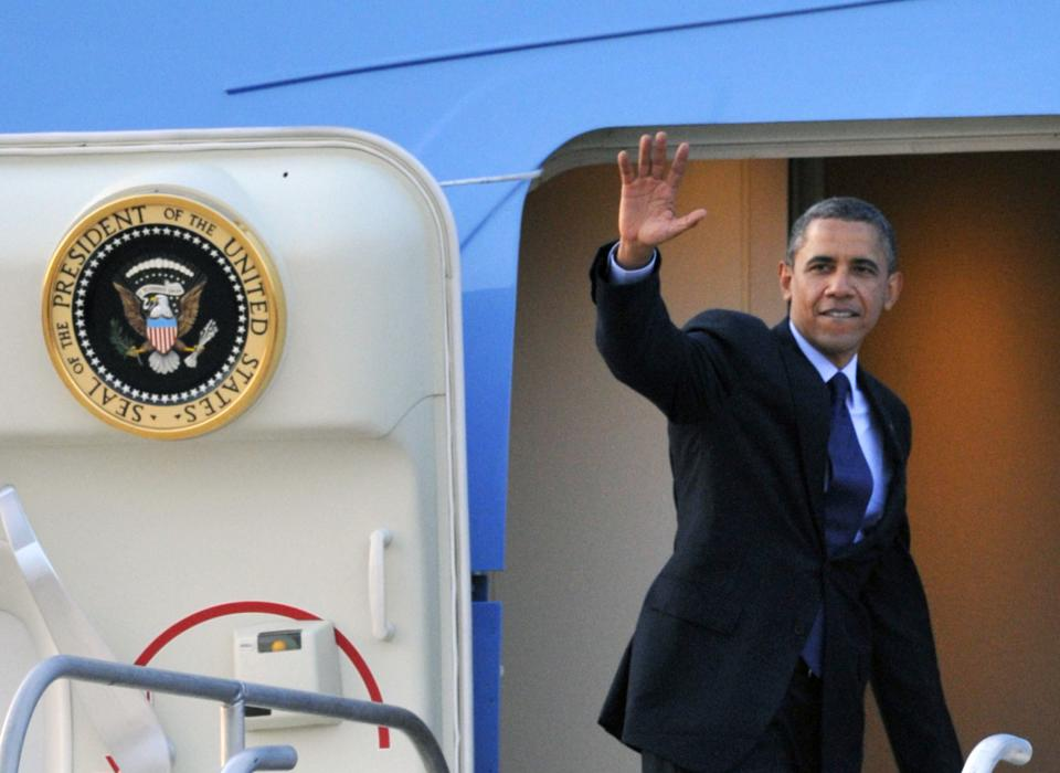 President Barack Obama waves as he boards Air Force One at Austin-Bergstrom International Airport Tuesday, July 17, 2012, in Austin, Texas. (AP Photo/Michael Thomas)