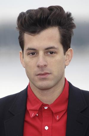 "FILE - British music producer and artist Mark Ronson poses at the 46th MIDEM (International record music publishing and video music market) in Cannes, southern France, in this Jan. 30, 2012 file photo. Ronson went from being the DJ at Paul McCartney's wedding to producing for the icon in the studio. Ronson said in an interview Thursday March 21, 2013 that he worked on three songs with the former Beatles singer. He called the process ""insane."" (AP Photo/Lionel Cironneau, File)"