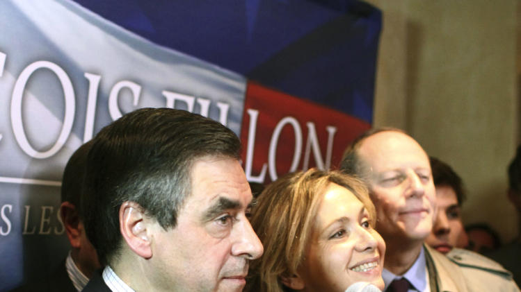 France's former Prime Minister Francois Fillon and candidate to head the conservative UMP party, center, addresses the media at his headquarters, in Paris, Sunday, Nov. 18, 2012. France's opposition UMP party voted Sunday for a successor to former president Nicolas Sarkozy in a race between Fillon and Jean-Francois Cope, the party's populist secretary-general. (AP Photo/Thibault Camus)