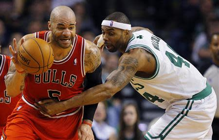 Chicago Bulls forward Boozer is fouled by Boston Celtics forward Wilcox in the second half of their NBA basketball game in Boston