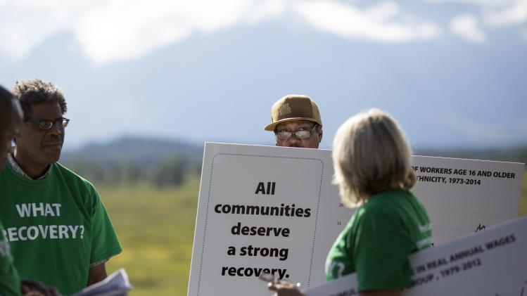 Reginald Rounds of Ferguson, Missouri protests during the opening reception of the Jackson Hole Economic Policy Symposium, in Jackson Hole