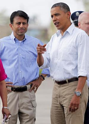 President Barack Obama speaks with Louisiana Gov. Bobby Jindal as he arrives at Louis Armstrong New Orleans International Airport in Kenner, La., Monday, Sept. 3, 2012. (AP Photo/Jonathan Bachman)