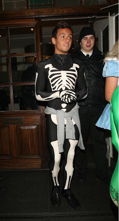 Tom Daley looking frankly skeletal in his Halloween costume. Copyright [Splash]