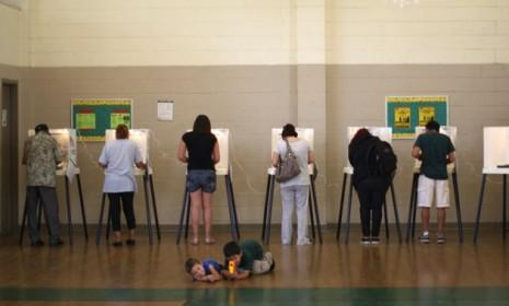 People vote at a school in Los Angeles, Calif., on Nov. 6: For millions of Americans, simply casting a ballot has become increasingly difficult.