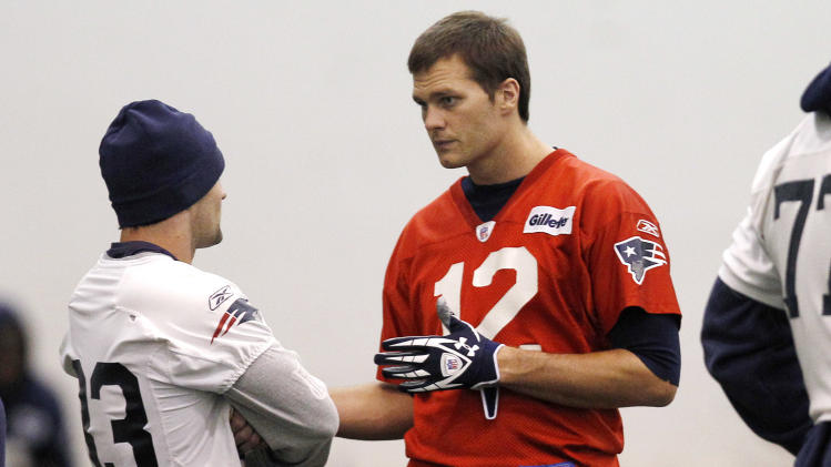 New England Patriots quarterback Tom Brady, right, talks with teammate Wes Welker during NFL football practice in Foxborough, Mass., Wednesday, Nov. 16, 2011.  (AP Photo/Charles Krupa)