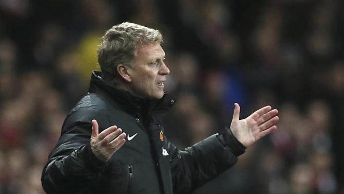 "In this Wednesday, Feb. 12, 2014 file photo Manchester United's manager David Moyes gestures to his team during their English Premier League soccer match between Arsenal and Manchester United at the Emirates stadium in London. Manchester United says manager David Moyes has left the Premier League club after less than a year in charge, amid heavy speculation he was about to be fired. United released a brief statement in its website Tuesday, saying the club ""would like to place on record its thanks for the hard work, honesty and integrity he brought to the role."""