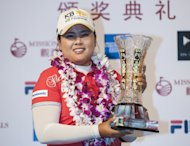 HAINAN ISLAND, HAINAN - MARCH 09: Inbee Park of South Korea poses with the trophy after winning the World Ladies Championship at Mission Hills' Blackstone Course on March 9, 2014 in Hainan Island, China. (Photo by Victor Fraile/Getty Images)
