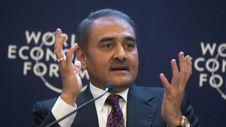 India's  Minister of Heavy Industries and Public enterprises, Praful Patel, gestures as he speaks during a debate on religion at the 43rd Annual Meeting of the World Economic Forum, WEF, in Davos, Switzerland, Friday, Jan. 25, 2013. Who created Davos, and why does it exist?  Questions about God and religion came up often at the World Economic Forum this year providing a break from the temporal concerns that tend to dominate Davos and showing that even the jet set is preoccupied with the meaning of life, at least in these turbulent times.(AP Photo/Michel Euler)