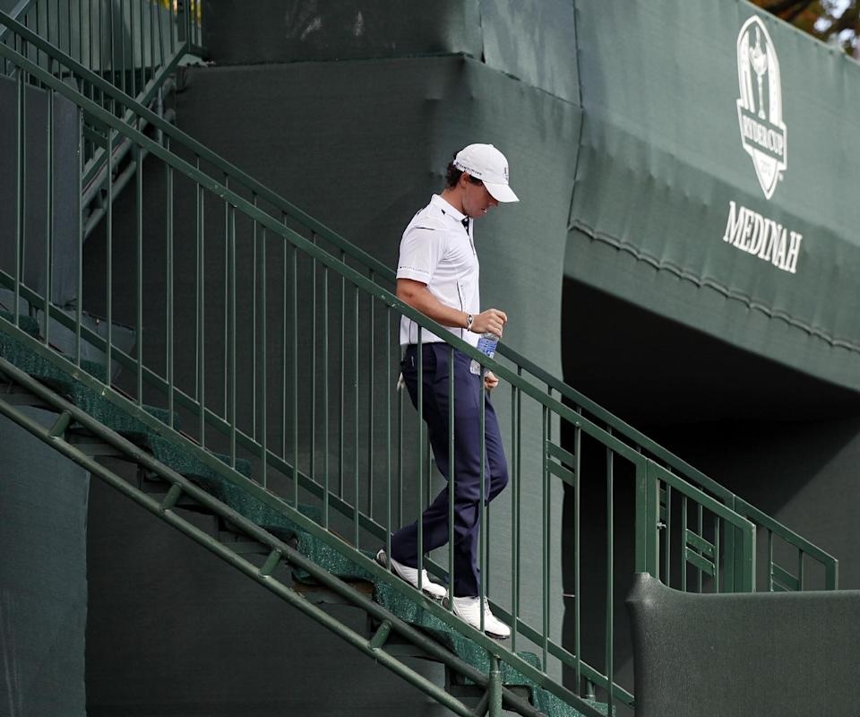 Europe's Rory McIlroy makes his way to the first tee before a singles match at the Ryder Cup PGA golf tournament Sunday, Sept. 30, 2012, at the Medinah Country Club in Medinah, Ill. (AP Photo/Charles Rex Arbogast)