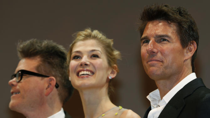 "U.S. actor Tom Cruise, right, British actress Rosamund Pike, center, and director Christopher McQuarrie smile during the Japan premiere of their new movie ""Jack Reacher"" in Tokyo,  Wednesday, Jan. 9, 2013. (AP Photo/Shizuo Kambayashi)"