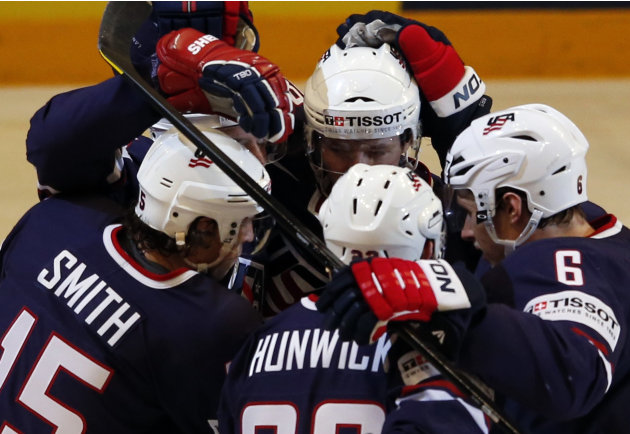 Team USA's Smith celebrates his goal against Finland with his teammates during their 2013 IIHF Ice Hockey World Championship bronze medal match at the Globe Arena in Stockholm
