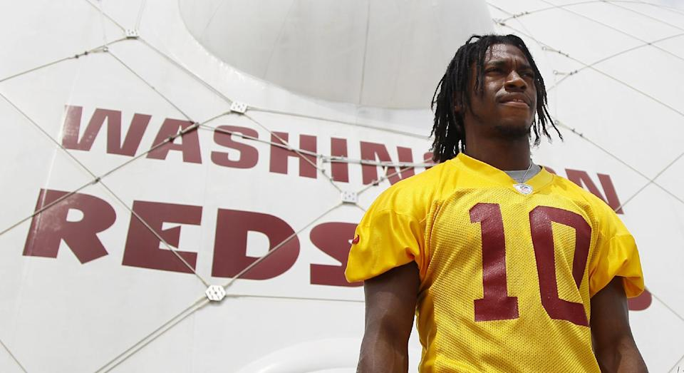 Washington Redskins quarterback Robert Griffin III walks from a morning practice during NFL football training camp at Redskins Park, Thursday, July 26, 2012, in Ashburn, Va. (AP Photo/Carolyn Kaster)