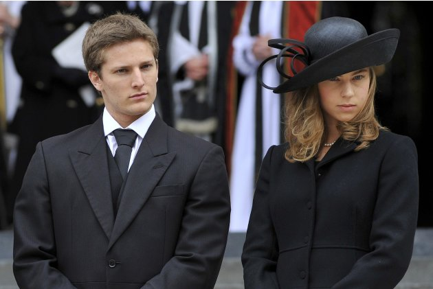 Michael and Amanda Thatcher, grand children of former British prime minister Margaret Thatcher, react as they leave her funeral service at St Paul's Cathedral in London