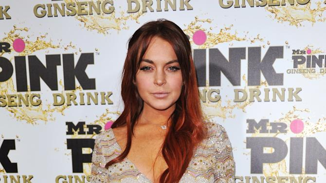 FILE - In this Oct. 11, 2012 file photo, Lindsay Lohan attends the Mr. Pink Ginseng launch party at the Beverly Wilshire hotel in Beverly Hills, Calif. Lohan sued a former collaborator on her legging and clothing line 6126 on Thursday Jan. 31, 2013, claiming D.N.A.M. Apparel owes her more than $1.1 million and is improperly using her trademarks. (Photo by Richard Shotwell/Invision/AP, File)