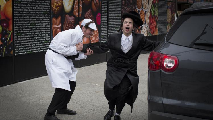 Men dance in the street during the Jewish holiday of Purim in the South Williamsburg suburb of New York