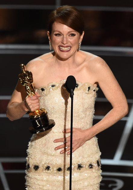 Julianne Moore accepts her award on stage at the 87th Oscars February 22, 2015 in Hollywood -- Getty Images