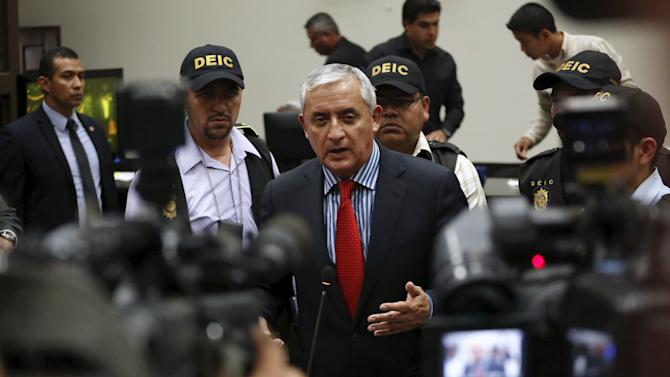Molina speaks with the media after a hearing at the Supreme Court of Justice in Guatemala City