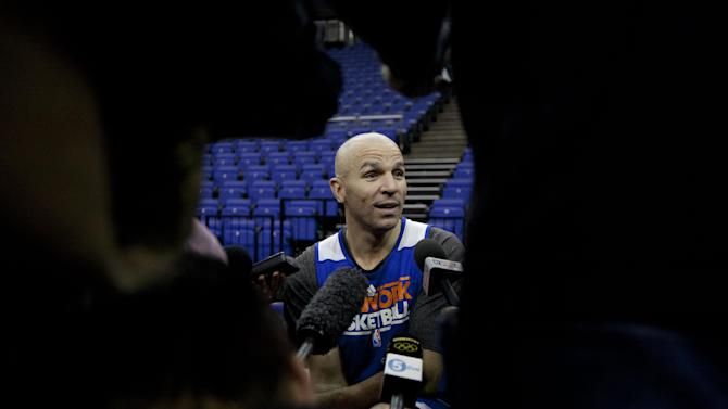 """New York Knicks player Jason Kidd speaks as he is interviewed by members of the media before a team training session at the 02 arena in London, Wednesday, Jan. 16, 2013.  The Detroit Pistons are due to play a """"home"""" NBA league game against the New York Knicks at the arena on Thursday.   (AP Photo/Matt Dunham)"""