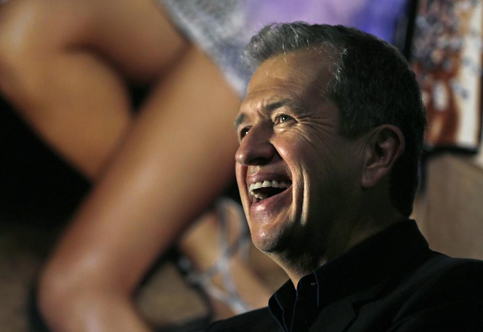 "Photographer Mario Testino laughs as he poses for a portrait during the preview of his shows ""In Your Face"" and ""British Royal Portraits"" at the Museum of Fine Arts in Boston, Wednesday, Oct. 17, 2012. (AP Photo/Charles Krupa)"