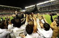 Real Madrid&#39;s players toss Real Madrid&#39;s Portuguese coach Jose Mourinho after winning the Spanish league title at the San Mames stadium in Bilbao on May 2. Jose Mourinho has declared that he has no ambition to coach in any new countries after Real Madrid&#39;s La Liga success gave him a haul of league titles from four different countries