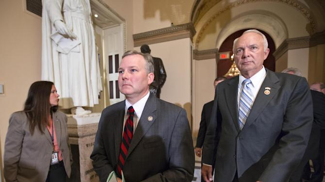 Rep. Tim Griffin, R-Ark., center, and Rep. John Kline, R-Minn., right, chairman of the House Education Committee, walk to the floor of the House of Representatives for a vote to delay the individual and employer mandates of President Barack Obama's signature health care law, at the Capitol in Washington, Wednesday, July 17, 2013. It's the 38th time the GOP majority has tried to eliminate, defund or scale back the program since Republicans took control of the House in January 2011. (AP Photo/J. Scott Applewhite)