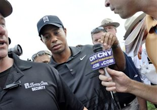 Tiger Woods makes his way off the course after the Notah Begay III Foundation Challenge golf tournament in Verona, N.Y., Wednesday, Aug. 31, 2011. (AP