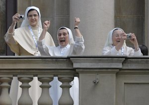 Nuns celebrate and take pictures as Pope Francis arrives…