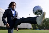 Christian Karembeu plays with a ball outside the FIFA headquarters on May 10, 2011 in Zurich. Greek champions Olympiakos announced Tuesday the appointment of France's 1998 World Cup winning midfielder Karembeu to an administrative role at the Super League club