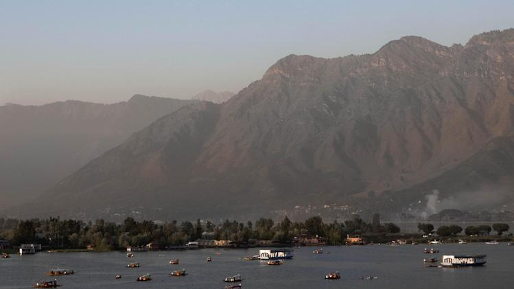 Tourists ride Shikara, or traditional boat, at the Dal Lake in Srinagar, India, Tuesday, Aug. 19, 2014. Both India and Pakistan control parts of Kashmir and claim it in its entirety. In a blow to efforts to improve often-hostile ties, India on Monday called off talks with Pakistan over a meeting between its ambassador and Kashmiri separatists. (AP Photo/Dar Yasin)