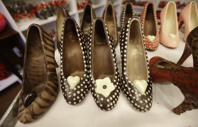 In this Feb. 7, 2013 photo, chocolate high heals made by master chocolatier Andrea Pedraza are lined up at her shop in the Oak Cliff section of Dallas. Florists and chocolate makers are working around the clock for the busy season - Valentine&#39;s Day. Pedraza&#39;s most well known creations are chocolate pumps done in the style of Christian Louboutin shoes. (AP Photo/LM Otero)