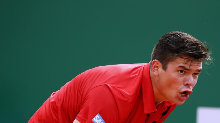 Raonic of Canada reacts after missing a point during his match against Wawrinka of Switzerland during their quarter-final match at the Monte Carlo Masters in Monaco