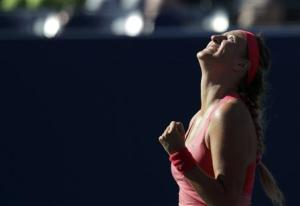 Azarenka of Belarus celebrates winning match point against Pennetta of Italy at the U.S. Open tennis championships in New York