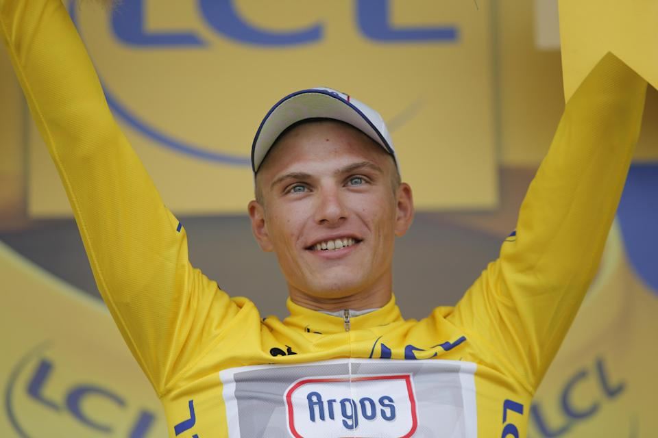 Marcel Kittel of Germany, wearing the overall leader's yellow jersey, celebrates on the podium of the first stage of the Tour de France cycling race over 213 kilometers (133 miles) with start in Porto Vecchio and finish in Bastia, Corsica island, France, Saturday June 29, 2013. (AP Photo/Christophe Ena)