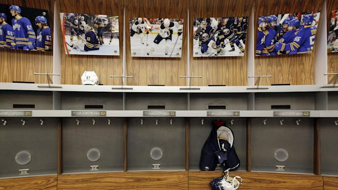 An empty Buffalo Sabres locker room is shown at the First Niagara Center, home of the Buffalo Sabres NHL hockey team, in Buffalo, N.Y., Tuesday, Sept. 25, 2012. The NHL and its union are to return to the bargaining table Friday, the first negotiations since the lockout began Sept. 15. (AP Photo/David Duprey)