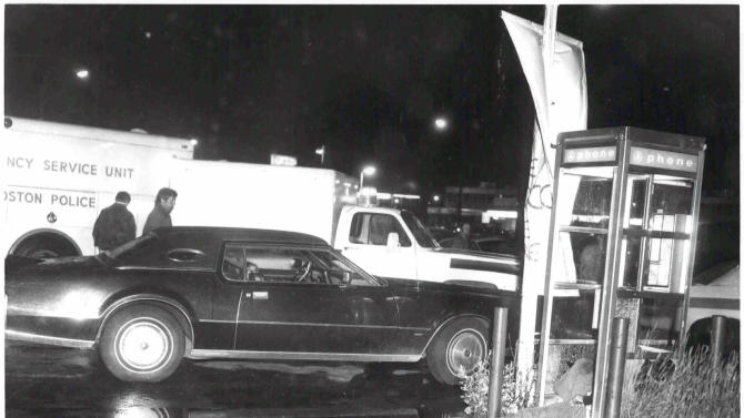 "This undated black and white photo released by the U.S. Attorney's Office and presented as evidence Wednesday, June 19, 2013, during the trial of James ""Whitey"" Bulger in U.S. District Court in Boston, shows a crime scene where a victim was shot to death in a telephone booth. Bulger, the reputed former head of the mostly Irish-American Winter Hill Gang based in South Boston, is accused of playing a role in 19 killings during the 1970s and '80s. (AP Photo/U.S. Attorney's Office)"