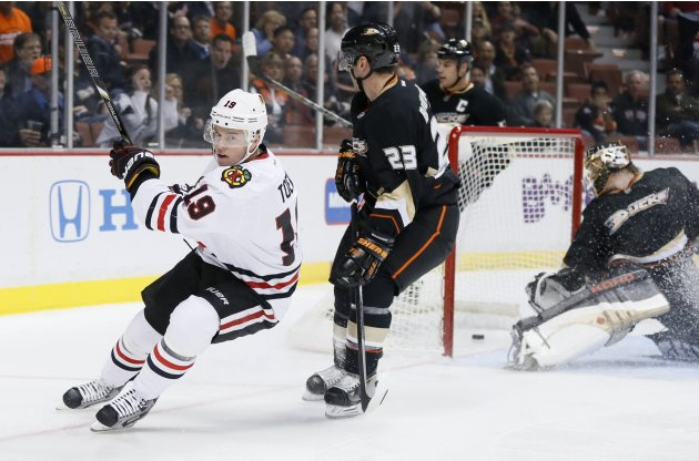 Chicago Blackhawks' Toews celebrates his short handed goal past Anaheim Ducks' goaltender Hiller, Beauchemin and Getzlaf during their NHL hockey game in Anaheim