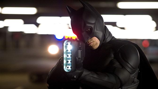 """This undated film image released by Warner Bros. Pictures shows Christian Bale as Batman in a scene from the action thriller """"The Dark Knight Rises.""""  A gunman in a gas mask barged into a crowded Denver-area theater during a midnight premiere of the Batman movie on Friday, July 20, 2012, hurled a gas canister and then opened fire, killing 12 people and injuring at least 50 others in one of the deadliest mass shootings in recent U.S. history. (AP Photo/Warner Bros. Pictures, Ron Phillips)"""