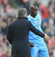 Roberto Mancini with Mario Balotelli (right)