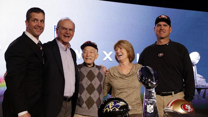 San Francisco 49ers head coach Jim Harbaugh and Baltimore Ravens head coach John Harbaugh pose with parents Jack and Jackie and grandfather Joe Cipiti during a news conference for the NFL Super Bowl XLVII football game Friday, Feb. 1, 2013, in New Orleans. (AP Photo/Mark Humphrey)