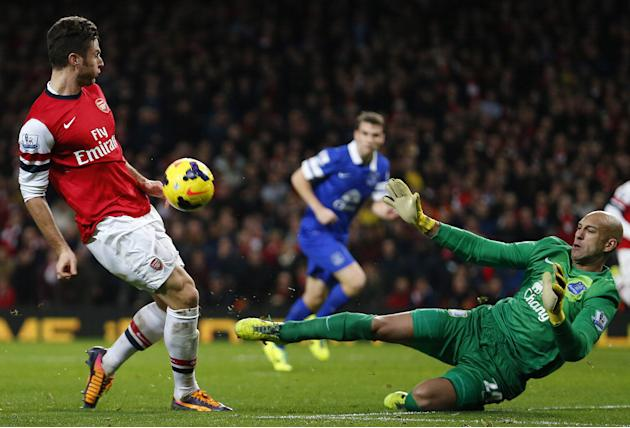 Everton's Howard saves a shot from Arsenal's Giroud during their English Premier League soccer match against The Emirates in London