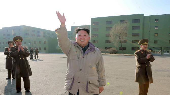 North Korean leader Kim Jong Un has a photo session with participants in the second meeting of KPA logistic personnel